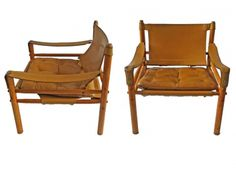A pair of safari-style Sirocco chairs by Arne Norell. Typical pegged construction, beech frames, original toffee-coloured leather strapping and loose cushions.   Sweden, c.1960.   W.65 x D.66 x H.71cm