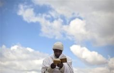"""An Ethiopian Jewish man prays during the """"Sigd"""" holiday in Jerusalem. The prayer is performed by Ethiopian Jews every year to celebrate the biblical union between the Jewish people and God. (Photo by Sebastian Scheiner / AP). First published in the November 14, 2012, 6:50 p.m. edition (http://dailysource.org/pictures/show/42569)."""