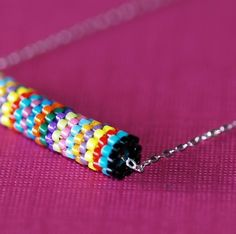 Fiesta Stripe...  a peyote tube with 14 fun bright colors, on a sterling silver chain -- fiesta!  :-)  $ 26