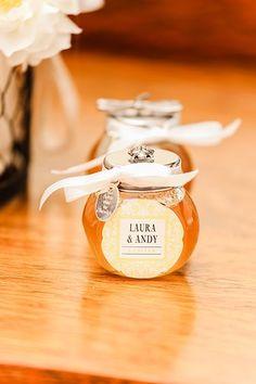 Glass favor jars of honey or jam
