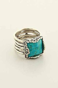 Turquoise Deal Band  Hand made, sterling silver with large Turquoise stone on a five wavy rings attached.  Price:$77.00