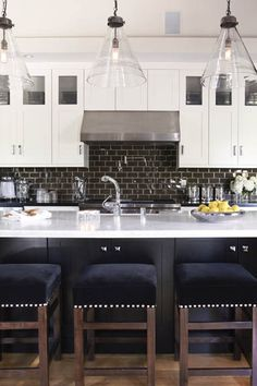ARTICLE:How A Bold, Stylish Kitchen Backsplash Can Make A Stunning Artistic Statement - diff color backsplash. Love the symmetry of stove, tile brick backsplash, kitchen sink island - yes!