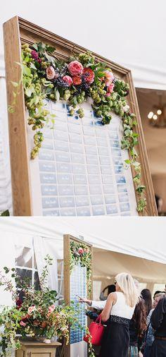 flower accented seatting assignment display @weddingchicks
