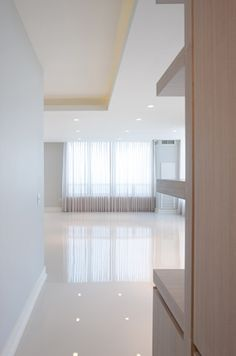 Contemporary Condo Great Room::Deb Reinhart Interior Design Group:: sleek modern minimal, white, concrete floors