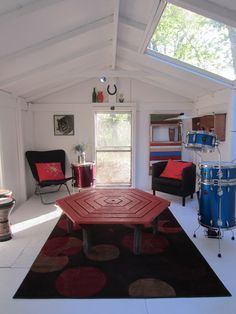 This was a very nasty shed! NICE - http://relaxshacks.blogspot.com/2013/05/deeks-crappy-shed-becomes-modern-rock.html