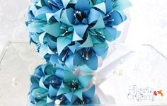 Buquê de Origami - Lírios I  Saiba mais em: http://hikarisorigami.wix.com/hikarisorigami