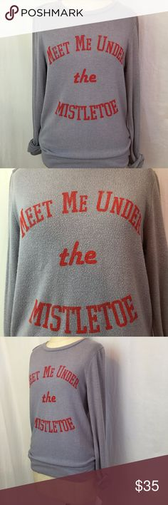 Signorelli Meet Me Under the Mistletoe Sweatshirt NWT Signorelli Meet Me Under the Mistletoe Sweatshirt has a Vintage, washed look , with fuzzy piling all over, although it is NWT.  Graphic Meet Me Under the Mistletoe is perfect for the Holiday season.  Cozy up with hot chocolate and fuzzy socks and watch all the best movie classics in this lightweigh but cozy pullover. Sku#007001000090017035-20 Signorelli Tops Sweatshirts & Hoodies