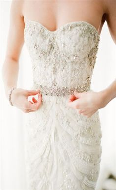 Not a fan of strapless gowns, I feel like everyone has one. I like the beading and lace on this though!