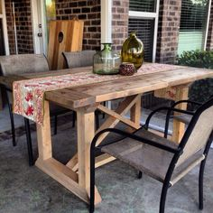 Check out this amazing DIY Farm Table on the patio.  Build it yourself for less!