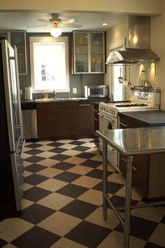 I've always dreamed of having a black and white kitchen floor.