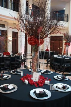 I really like the idea of navy table cloths and red rose petals around the center pieces and a couple of white candles lit -Michelle