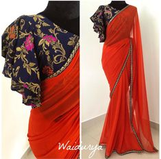 Stunning red color designer saree with designer blous… Diwali capsule collection. Stunning red color designer saree with designer blouse. Blouse with bell… Modern Blouse Designs, Stylish Blouse Design, Sari Bluse, Indische Sarees, Saree Blouse Neck Designs, Saree Jacket Designs Latest, New Saree Designs, Sleeves Designs For Dresses, Sleeve Designs