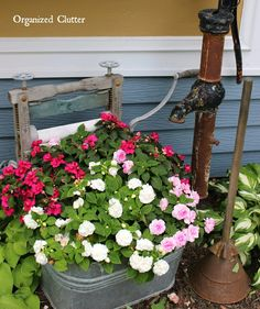 <em class=short_underline>   </em>     Here double impatiens are planted in a square laundry tub.     <em class=short_underline>   </em>     Nicotiana, petunias and lobelia in an old oak barrel and petunias, calibrachoa, and verbena in a junky ice cream freezer.      <em class=short_underline>   </em>     Verbena, petunias and alyssum in a galvanized garbage pail.      <em class=short_underline>   </em>     Orange zinnias and lantana in a bucket on a rustic garden stool.      <em…