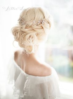 Romantic loosely braided low updo wedding hairstyle with chic white hair vine; Featured Hairpiece: Lottie Da Designs
