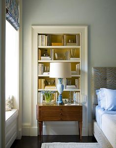 """The true definition of """"built in"""", this bookcase is literally built into the wall which is the way it used to be done, and a great small space solution.  I prefer this to what we call built-ins today which are, instead, shelving units built out and attached to the surface of the wall."""