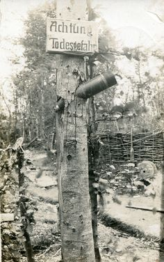 "A german ""beware of death"" sign above an unexploded shell stuck in a tree WW1.[ 1011 x 1612] http://ift.tt/2g4ZMIT"