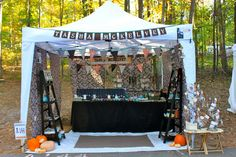 Tasha McKelvey's booth.  Note two side displays, open fabric flaps for breeze, pumpkins (very inviting) and prominent name display