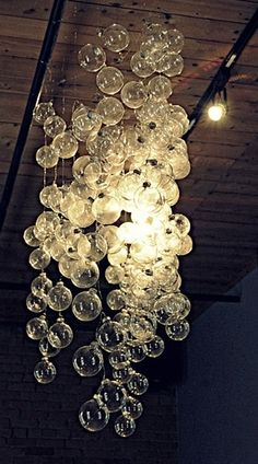 {DIY bubble chandelier made from clear Christmas ornaments on string}