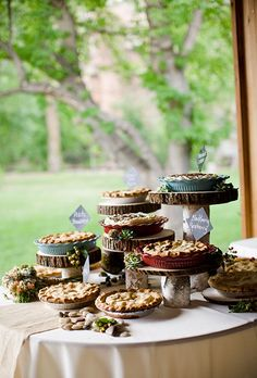 Ideas for breaking out of the mold of a traditional wedding cake. A Multi-Level Cake Display of Pies Nontraditional Wedding Cake Ideas Pie Bar Wedding, Wedding Cake Display, July Wedding, Wedding Desserts, Table Wedding, London Wedding, Dessert Bars, Buffet Dessert, Dessert Tables