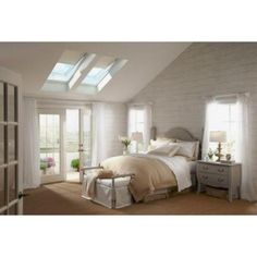 VELUX skylights are an energy-efficient way to bring sunlight into a home and make dark rooms come to life. Bringing natural light into a home through a skylight decreases the need for electricity while Traditional Bedroom Design, Feature Wall Bedroom, Home, Home Bedroom, Dreamy Bedrooms, Beautiful Bedrooms, House Interior, White Bedroom Furniture, Stylish Bedroom