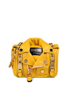this is a purse that costs $1265 dollars of real money and looks like a tiny yellow leather jacket.