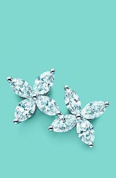 TIFFANY VICTORIA Exquisite Tiffany flowers bloom in marquise and round brilliant diamonds set in platinum.