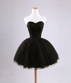 This sweetheart corset mini dress reflects the fashion style of the 1870s-1890s with the use of the corset. While the gown shows styles of contemporary fashion using tulle and a cupcake style mini dress, it shows poplar styles of the past as well. The dress is also lace up, which makes it more like a corseted dress as well. 1/15/16.