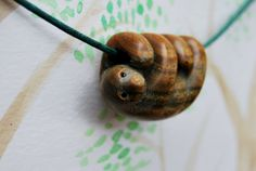 Sloth necklace carved from argentinian by AnimaliaWoodcarvings