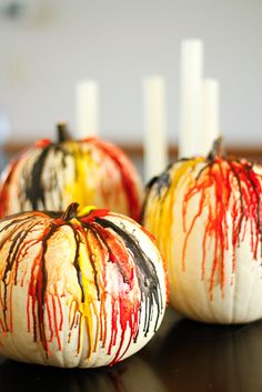 DIY Crayon Drip Pumpkins -- inspired by those crayon drip paintings, these crayon drip pumpkins are a fantastic decorating idea for both Halloween and Thanksgiving! | via @unsophisticook on unsophisticook.com