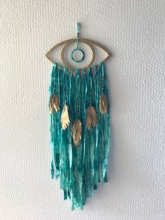 This Evil eye wall hanging is just one of the custom, handmade pieces you'll find in our wall hangings shops.Excited to share this item from my shop: Evil eye wall hanging Dream Catcher Craft, Dream Catcher Boho, Yarn Crafts, Diy Crafts, Fabric Crafts, Diy Dream Catcher Tutorial, Little Presents, Teal Fabric, Feather Painting