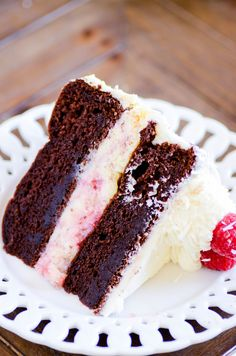 A layer of white chocolate raspberry cheesecake (inspired by the Cheesecake Factory!) sandwiched in between two layers of my favorite chocolate cake frosted in white chocolate buttercream. A few things to note about this recipe: I make the raspberry swirl in the cheesecake from scratch– and it is AMAZING. But if you need to take …