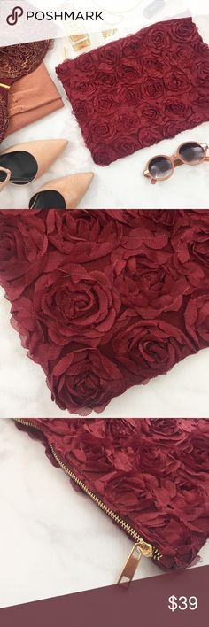 """Burgundy Rosette Clutch Details: * Soft fabric clutch with rosettes all over * Gold zipper closure  * Inner zip pocket and slip pocket * 9.5"""" H x 12"""" W * NWOT Nila Anthony Bags Clutches & Wristlets"""
