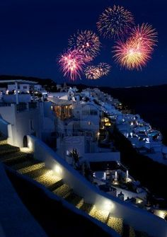 Fireworks night over Greek holiday resort Oia village Santorini Stock Photo