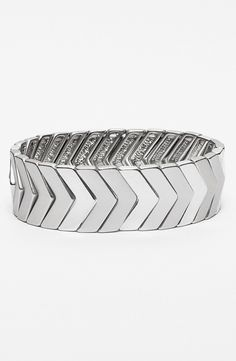 Add a touch of modern metal to any look with this gleaming silver chevron bracelet.