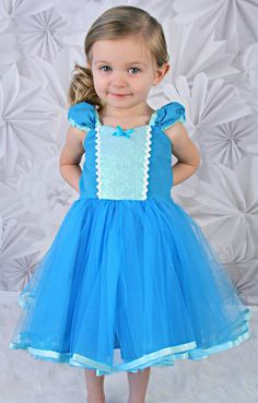 ELSA DRESS This is a fun new tutu dress for your little girl. This dress has a sweetheart neckline, inset details, cute gathered strap