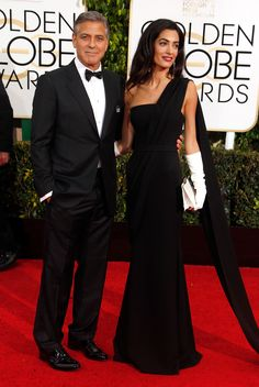 The newlyweds George Clooney and Amal Clooney in Dior Haute Couture at the Golden Globes 2015