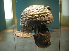 Horseman's helmet (Reiterhelm), detail proper right showing olive wreath (Olivenkranz) and patterning of hair, 1st half of the 1C CE, iron and gilt silver (Eisen, silber vergoldet). From the River Rhine near Xanten (Aus dem Rhein bei Xanten); now Bonn, LVR-LandesMuseum
