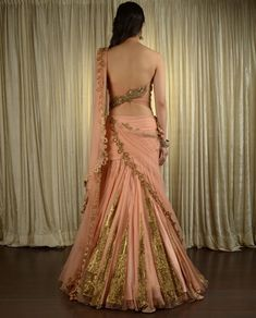 I love the back of this lengha but not sure of the gold in the skirt
