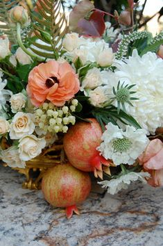 love the combo of the peach ranunculus with the poms.