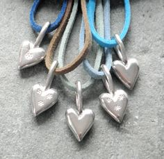 stamped silver hearts on a coloured chords by Cathy Newell Price Jewellery
