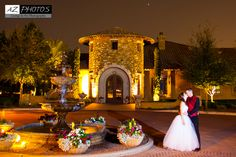 Bride & Groom sharing a kiss outside the entrance of Villa Siena in front of a fountain | villasiena.cc