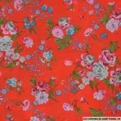 http://www.les-coupons-de-saint-pierre.fr/11000-23779-thickbox/coton-imprime-fleurs-creme-rose-et-bleu-sur-fond-orange.jpg