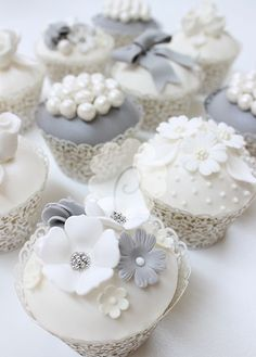 Aunt M has a baker that could do cupcakes instead of a cake if you prefer? White and Blue Floral Wedding Cupcakes Cupcakes Flores, Floral Cupcakes, Fancy Cupcakes, Pretty Cupcakes, Beautiful Cupcakes, Silver Cupcakes, Elegant Cupcakes, Amazing Cupcakes, Fondant Cupcakes
