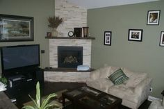 Classic white stone tile corner fireplace living room