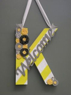 cute classroom decor welcome sign with teacher initial.
