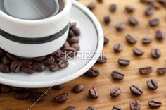 cup of coffee drink with beans - Close-up shot of coffee drink with beans on table surface