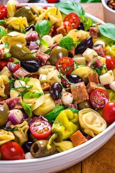 Antipasto Tortellini Pasta Salad - Host The Toast - Antipasto Tortellini Pasta Salad. This packed potluck favorite includes multiple cheeses, meats, olives, peppers, and more to create a hearty Italian-inspired summer side dish. Antipasto Salad, Appetizer Salads, Potluck Salad, Antipasto Skewers, Fruit Salad, Antipasto Platter, Italian Appetizers, Antipasta Salad Recipe, Brunch Salad
