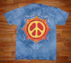This is a printed version of my Peace Sun Design. The original goes for $100.00, because it takes about six hours to prepare for dye, but thanks to the water based jet print technique designed by The Mountain Corporation, of Keene New Hampshire, I am able to sell these prints for $25.00    Wholesale inquiries are welcome~