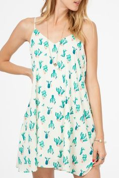 Cactus and Flower Print Swing Dress Side Pockets Fully Lined Spaghetti Straps Colors: Cream and Jade Material: 100% Polyester