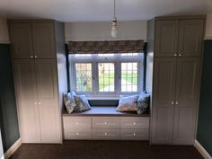Shaker-beaded style wardrobe with built in window seat.